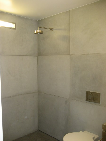 Concrete And Marble Bathroom
